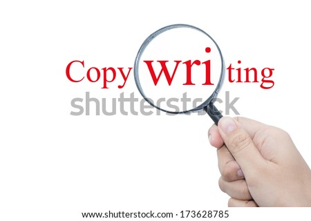 Hand Showing Copywriting Word Through Magnifying Glass