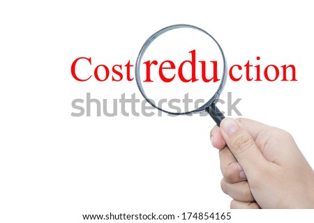 Hand Showing Cost reduction Word Through Magnifying Glass  - stock photo