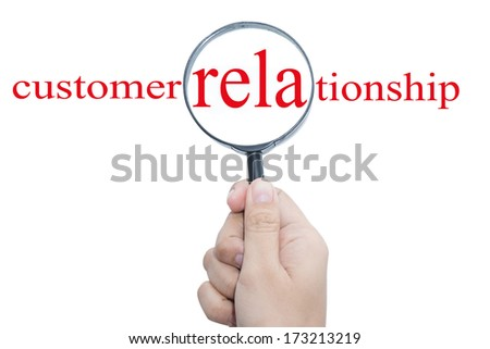 Hand Showing customer relationship Word Through Magnifying Glass  - stock photo