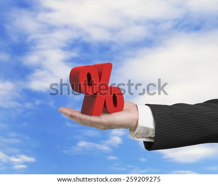 Hand showing 3D red percentage sign with sky cloud background - stock photo