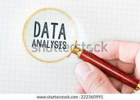 Hand Showing Data Analysis Words Through Magnifying Glass - stock photo