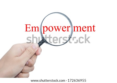 Hand Showing Empowerment Word Through Magnifying Glass  - stock photo