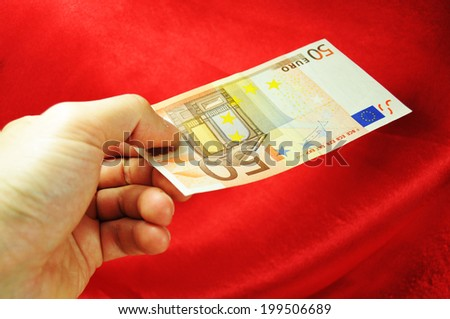Hand showing fifty euro banknote  - stock photo