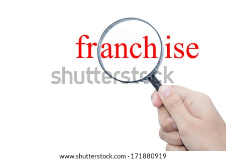 Hand Showing franchise Word Through Magnifying Glass  - stock photo