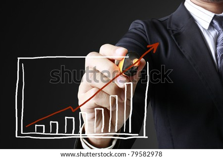 Hand showing graph - stock photo