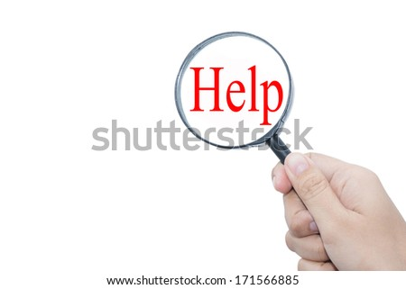 Hand Showing  Help Word Through Magnifying Glass - stock photo