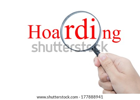 Hand Showing hoarding Word Through Magnifying Glass  - stock photo