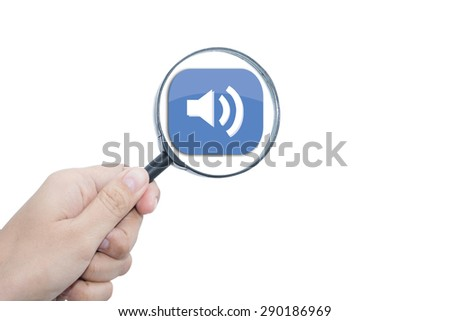 Hand Showing ispeaker icon Through Magnifying Glass  - stock photo