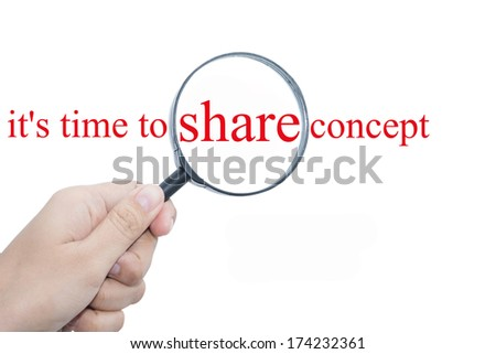 Hand Showing it's time to share concept Word Through Magnifying Glass  - stock photo