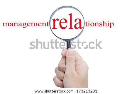 Hand Showing management relationship Word Through Magnifying Glass  - stock photo