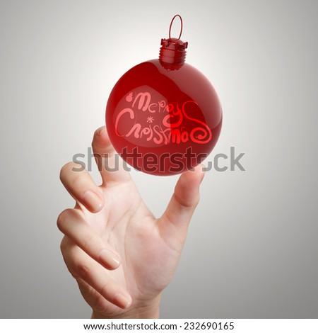hand showing Merry Christmas in ornament ball