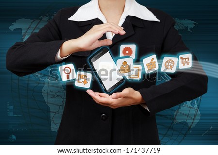 Hand showing mobile phone with icons. Concept of communication in the network.