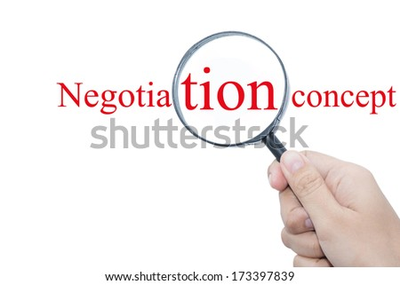 Hand Showing Negotiation concept Word Through Magnifying Glass  - stock photo