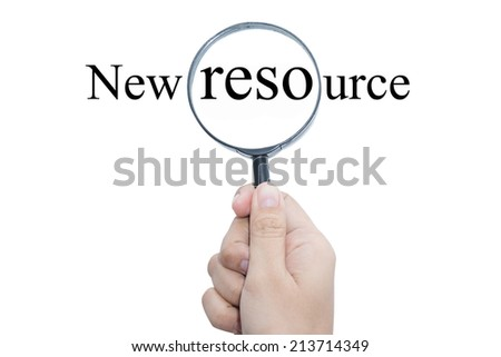 Hand Showing New resource Word Through Magnifying Glass  - stock photo