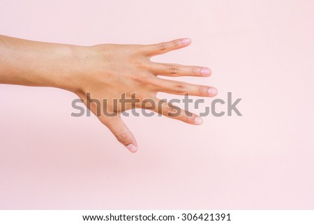 Hand showing on pink background - stock photo