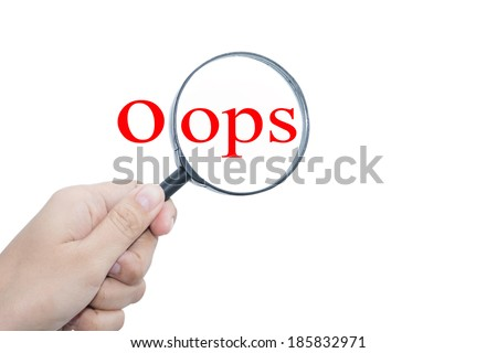 Hand Showing oops Word Through Magnifying Glass  - stock photo