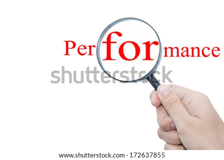 Hand Showing Performance Word Through Magnifying Glass  - stock photo