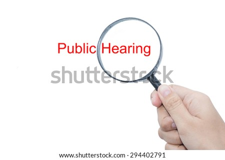Hand Showing Public Hearing Word Through Magnifying Glass