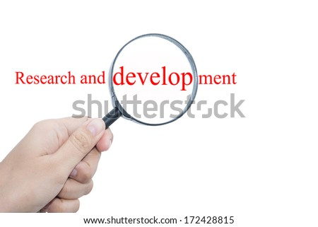 Hand Showing Research and development Word Through Magnifying Glass  - stock photo