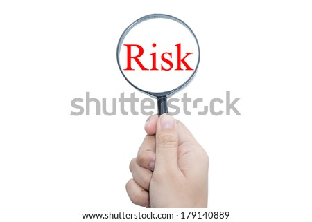 Hand Showing risk Word Through Magnifying Glass