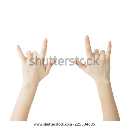 Hand showing rock sign - stock photo