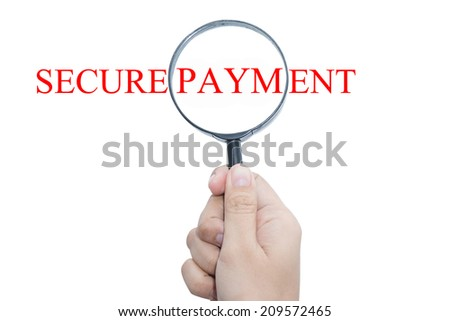 Hand Showing SECURE PAYMENT Word Through Magnifying Glass  - stock photo