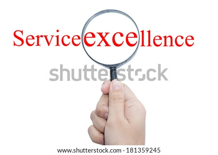 Hand Showing Service excellence Word Through Magnifying Glass  - stock photo