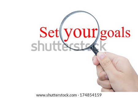 Hand Showing Set your goals Word Through Magnifying Glass  - stock photo