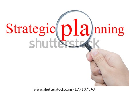 Hand Showing strategic planning Word Through Magnifying Glass  - stock photo