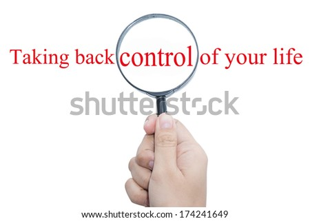 Hand Showing Taking back control of your life Word Through Magnifying Glass   - stock photo