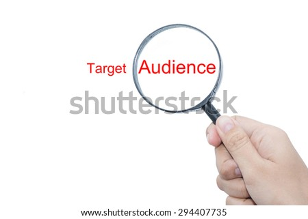 Hand Showing Target Audience Word Through Magnifying Glass  - stock photo