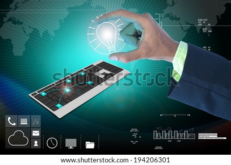 Hand showing the light bulb and computer keyboard - stock photo