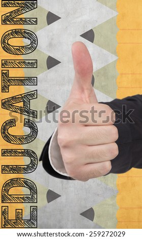 hand showing  thumb up and drawing education symbol on background - stock photo