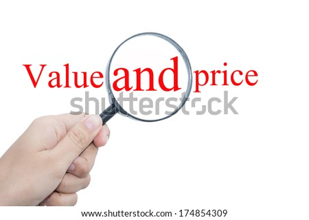 Hand Showing Value and price Word Through Magnifying Glass  - stock photo