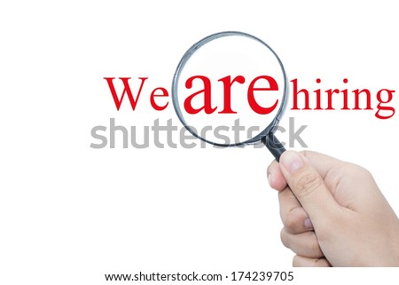Hand Showing We are hiring Word Through Magnifying Glass  - stock photo