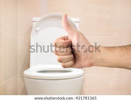 Hand sign good thumb up with background cleaning toilets bathroom toilet  - stock photo