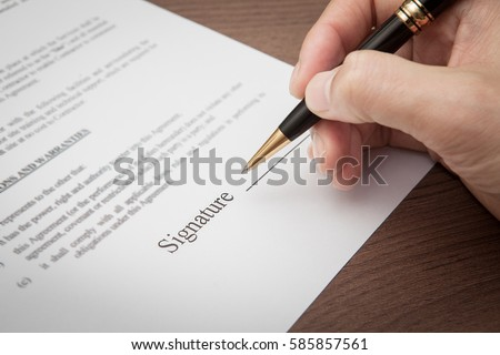 hand sign on contract document in office