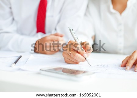 hand signing documents (soft focus on a pen) - stock photo