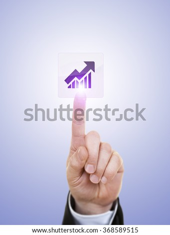 Hand simulating pressing business graph icon with index finger, on a blue background. - stock photo
