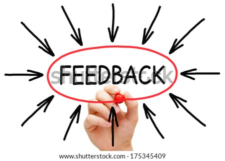 Hand sketching Feedback concept with marker on transparent wipe board. - stock photo