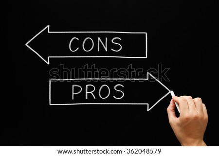 Hand sketching Pros Cons arrows concept with white chalk on a blackboard.