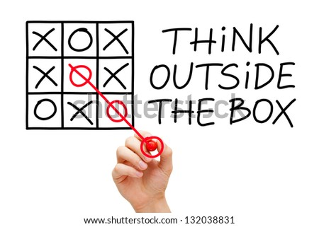 Hand sketching Think Outside The Box concept with red marker on transparent wipe board. - stock photo