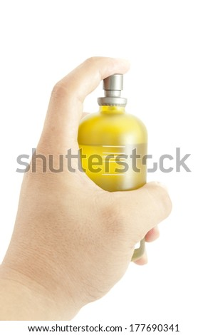 Hand spraying cologne from a bottle isolated on white - stock photo