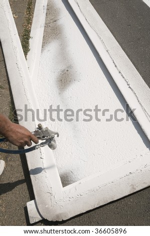 Hand spraying of pedestrian crosswalk at a street