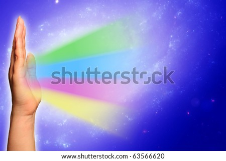 hand spreading rainbow-like light - stock photo