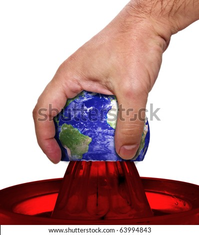 Hand squeeze earth - stock photo