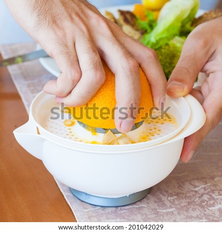 hand squeeze orange manual citrus juicer - stock photo