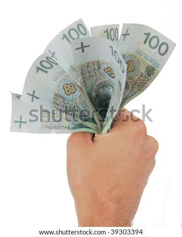 Hand squeezing bunch of banknotes against white background - stock photo
