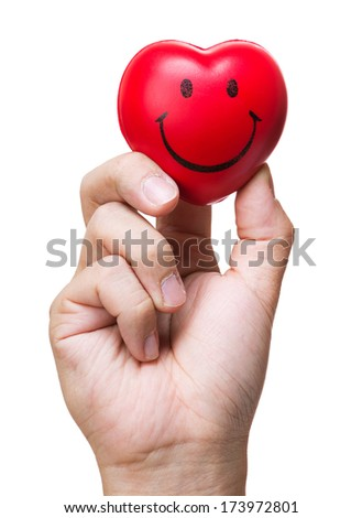 Hand squeezing stress ball in heart shape - stock photo