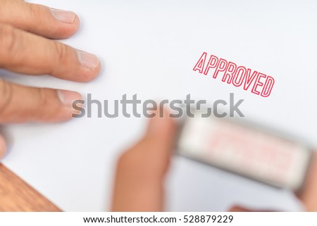Hand stamp approved on paper